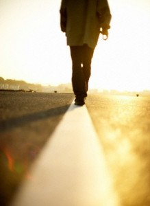 Man Walking Down the Line in the Road